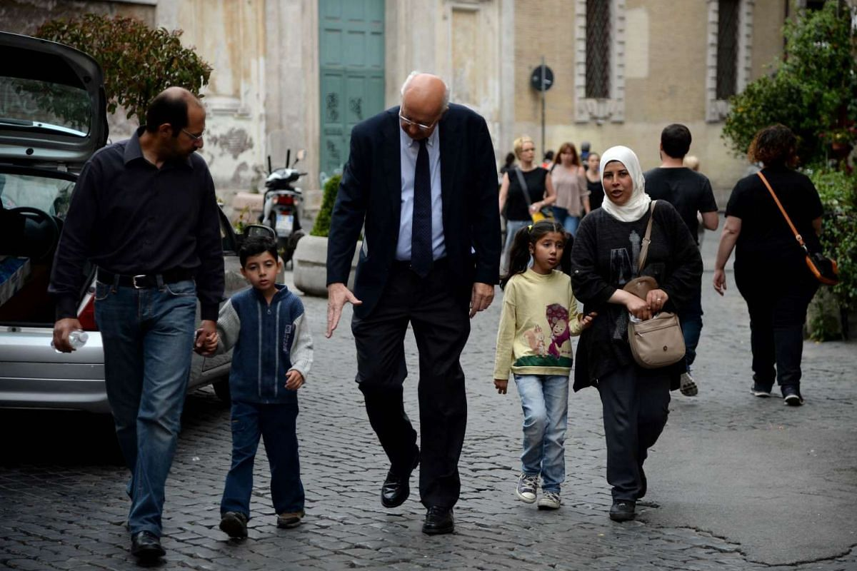 A family of Syrian refugees Pope Francis brought back with him from Greek island Lesbos arrive at the St Egidio Roman Catholic Charity on April 18, 2016.