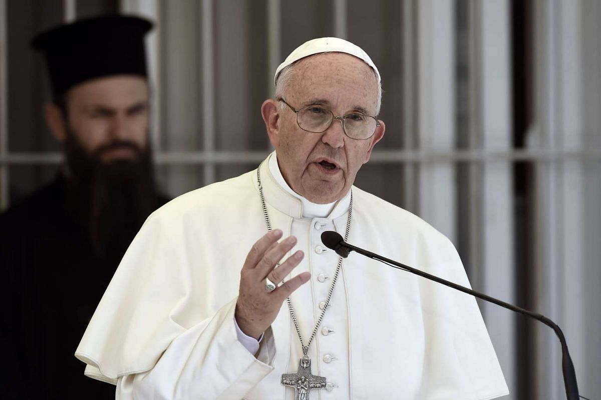 Pope Francis delivers a speech at the Moria detention centre in Mytilene on April 16, 2016.
