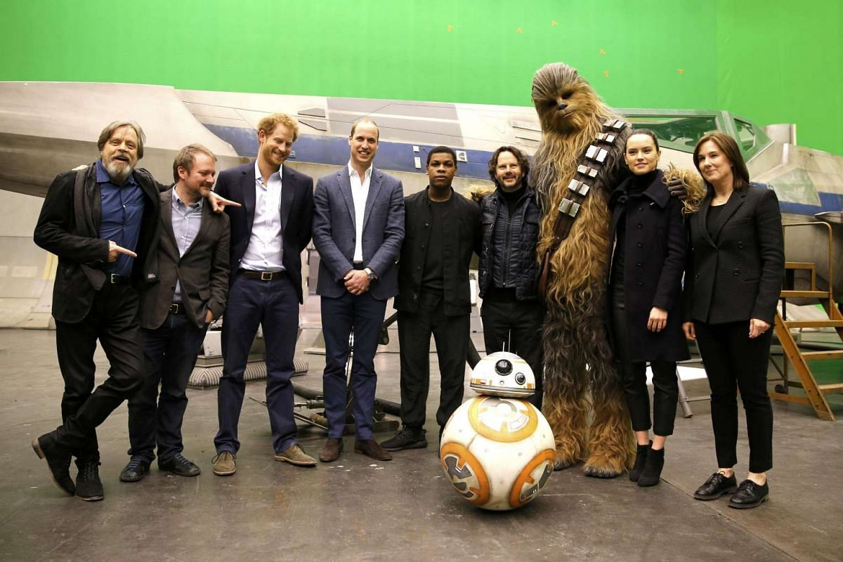 (Left to right) Mark Hamill, director Rian Johnson, Prince Harry, Prince William, John Boyega, producer Ram Bergman, Chewbacca, Daisy Ridley and producer Kathleen Kennedy pose during a tour of the Star Wars sets at Pinewood studios, London, on April
