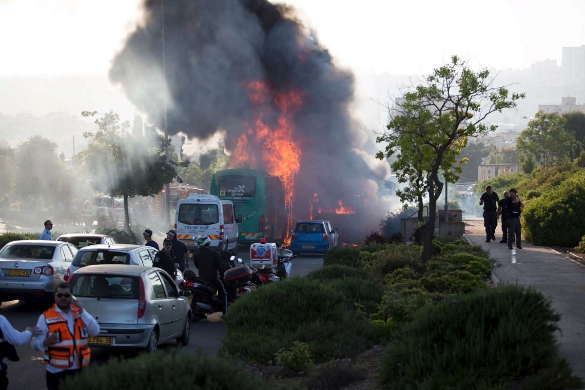 Flames rising at the scene where an explosion tore through a bus in Jerusalem on Monday setting a second bus on fire, in what an Israeli official said was a bombing, on April 18, 2016.