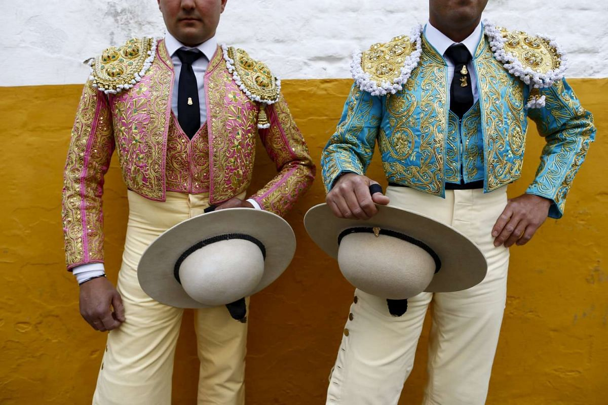 Spanish picadores Francisco Romero (left), 26, and Agustin Romero, 25, posing for a portrait before a bullfight at the Real Maestranza bullring in the Andalusian capital of Seville, southern Spain, on April 5, 2016.