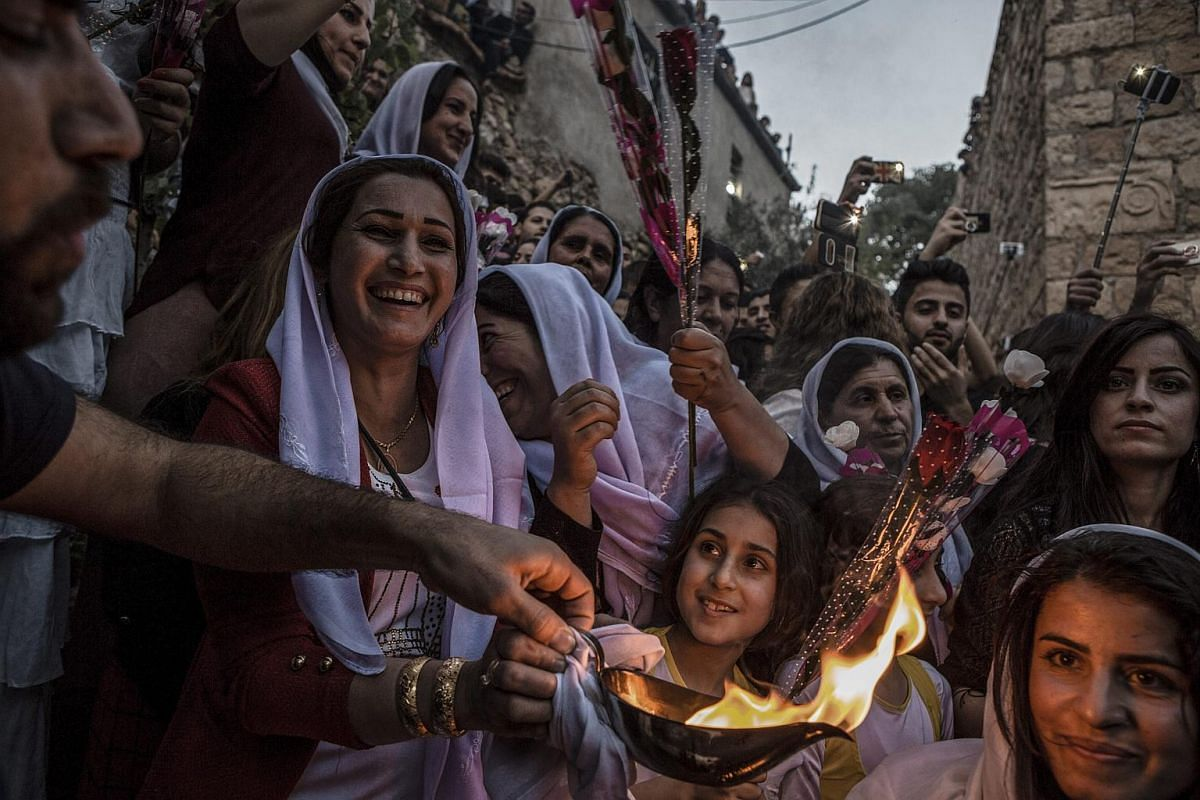 Yazidis gathering at the shrine of Sheikh Adi ibn Musafir to celebrate their new year with the lighting of candles in Lalish, north of Mosul, Iraq, on April 19, 2016.