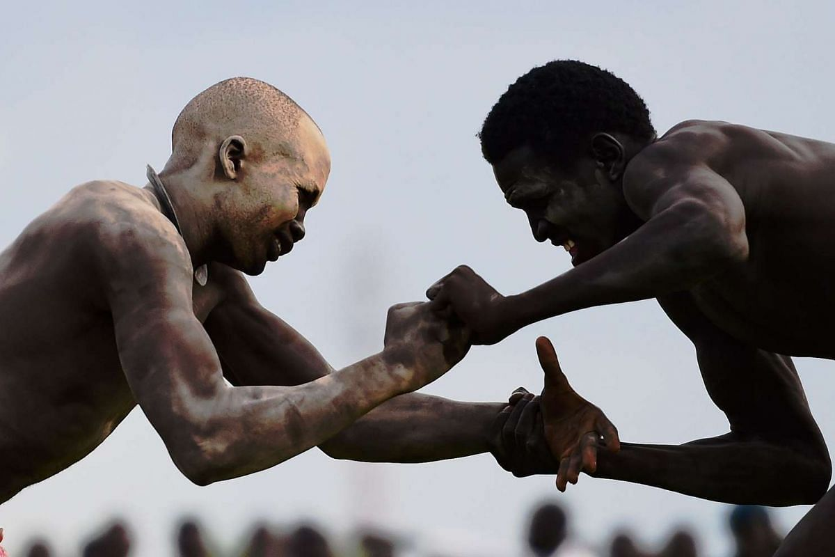Wrestlers from Jonglei and the Eastern Lakes states take part in the South Sudan National Wrestling Competition for peace at Juba Stadium, South Sudan on April 20, 2016.