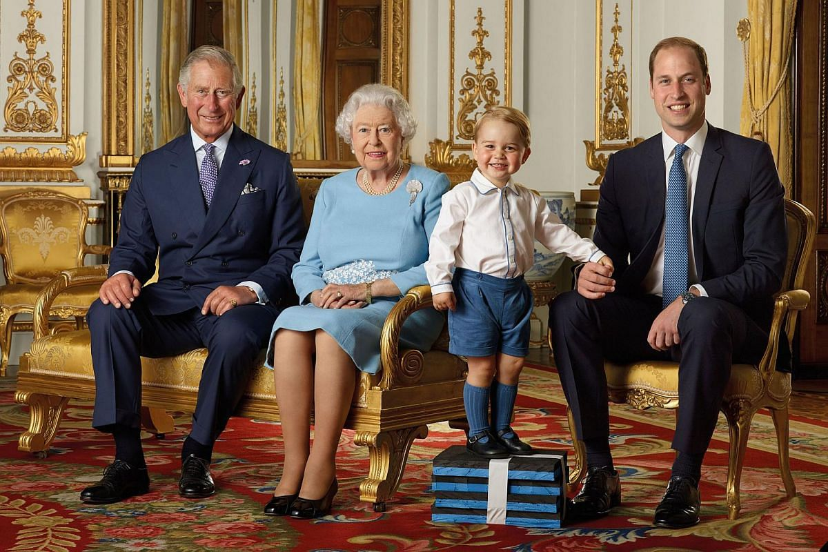Four generations in one picture: Britain's Prince Charles, Prince of Wales, Britain's Queen Elizabeth II, Britain's Prince George, and Britain's Prince William, Duke of Cambridge smiling during a photo shoot for the Royal Mail in 2015.