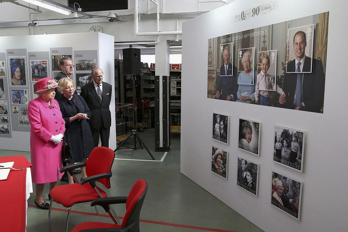 Queen Elizabeth II visits the Queen Elizabeth II delivery office in Windsor with Prince Philip, Duke of Edinburgh (right).