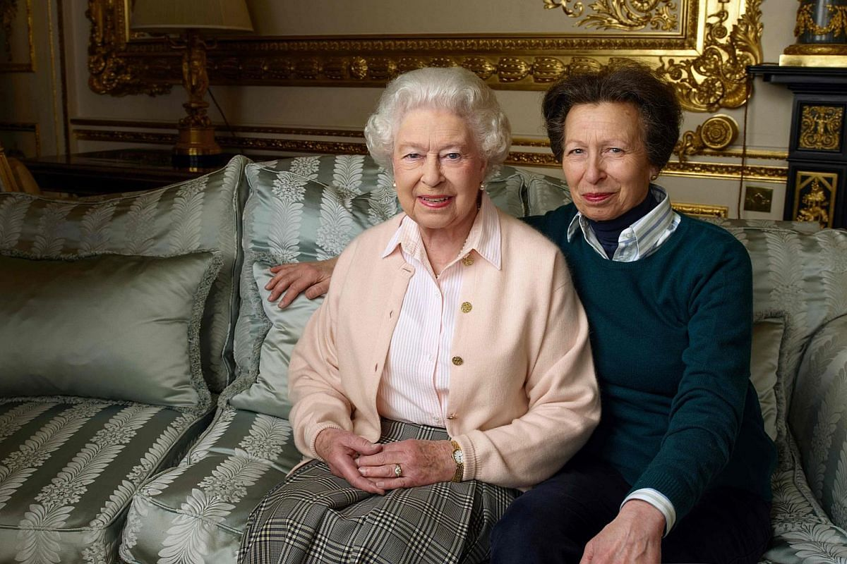 This handout portrait picture taken by US photographer Annie Liebovitz shows Queen Elizabeth II (left) posing with her daughter Princess Anne in the White Drawing Room of Windsor Castle.