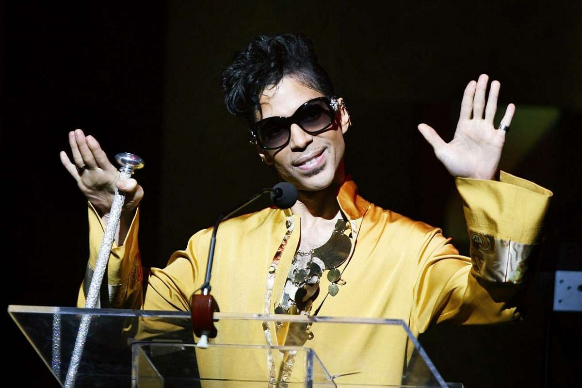 Prince gesturing on stage during the Apollo Theatre's 75th anniversary gala in New York, on June 8, 2009. PHOTO: REUTERS
