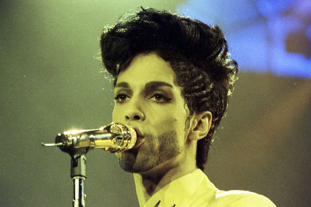 Prince performs during his Diamonds and Pearls Tour at the Earl's Court Arena in London, Britain, on June 15, 1992.