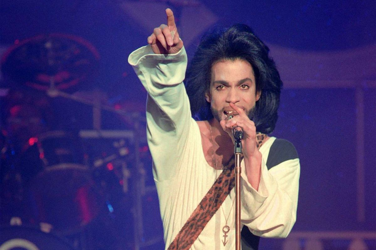 Prince performing onstage during his concert at the Parc des Princes stadium in Paris, on June 16, 1990.