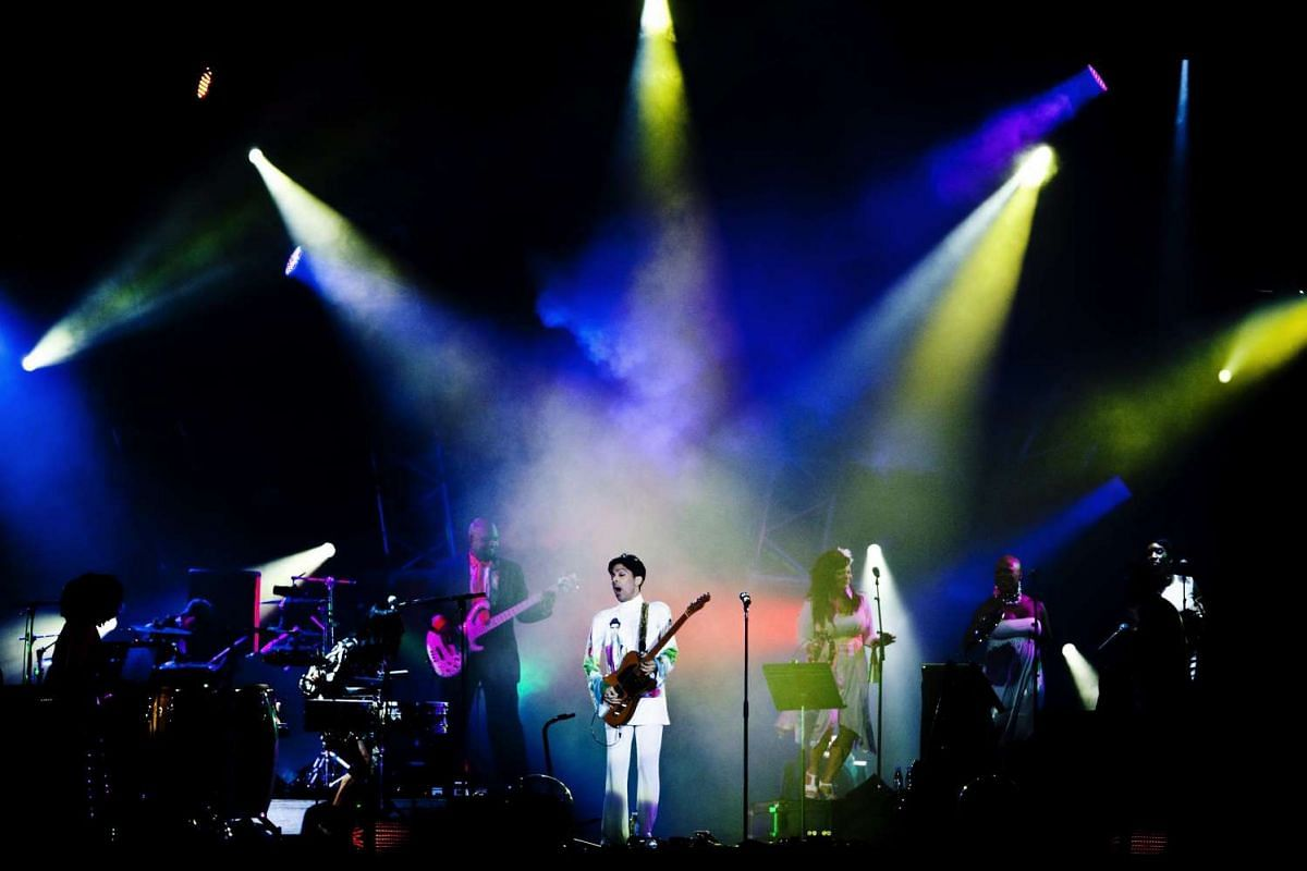 Prince performs on stage in concert at the Roskilde Festival, Denmark, on July 4, 2010.