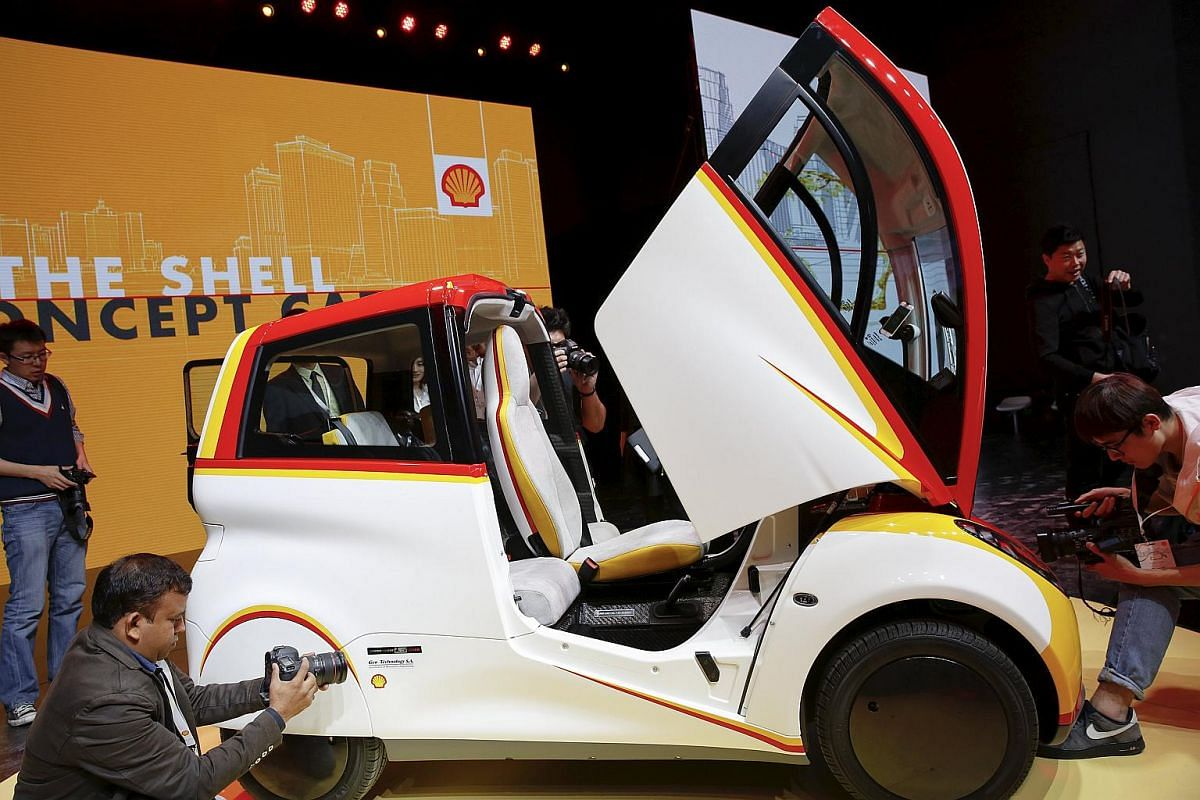 People taking pictures of a high-efficiency petrol-burning concept car as it is unveiled by Royal Dutch Shell in Beijing, China, on April 22, 2016.