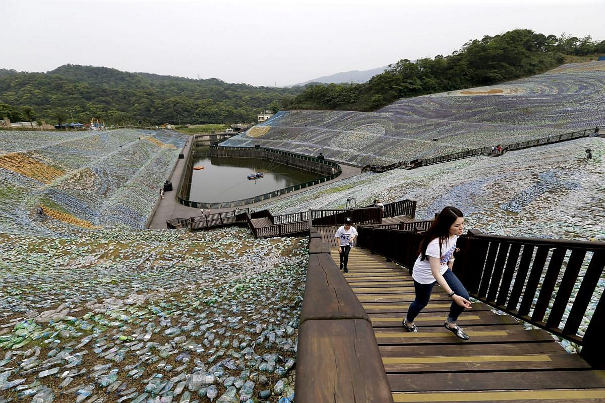 People walking around The Starry Paradise, a recreation of Van Gogh's The Starry Night, made from plastic bottles at the Embrace Cultural and Creative Park in Keelung, Taiwan, on April 21, 2016.