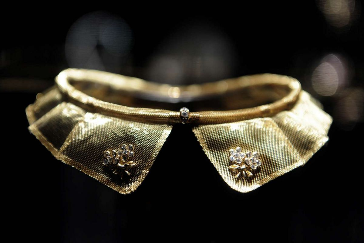 A Peter Pan-collar necklace made of gold on display in the Couture room of the exhibition.