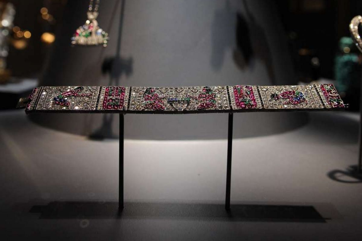 An Egyptianinspired bracelet, found in the Influences section, made of sapphires, rubies, emeralds, onyx and diamonds.