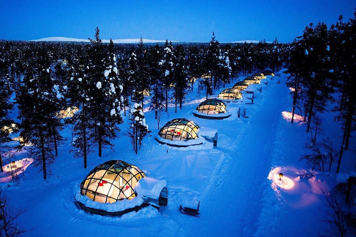 The Northern Lights over a fjord in Iceland. Glass igloos provide views of the Northern Lights in Finland.