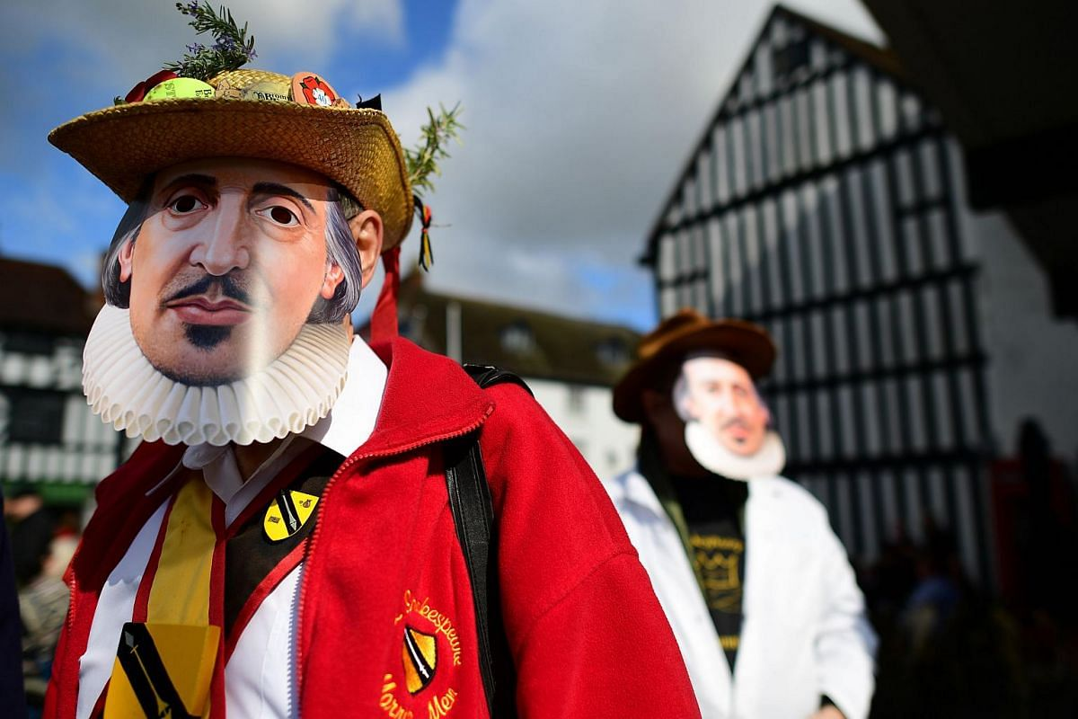 Wearing costumes and masks, members of the public prepare for the parade marking the 400 years since the death of William Shakespeare, in Stratford-upon-Avon in central England on April 23, 2016.