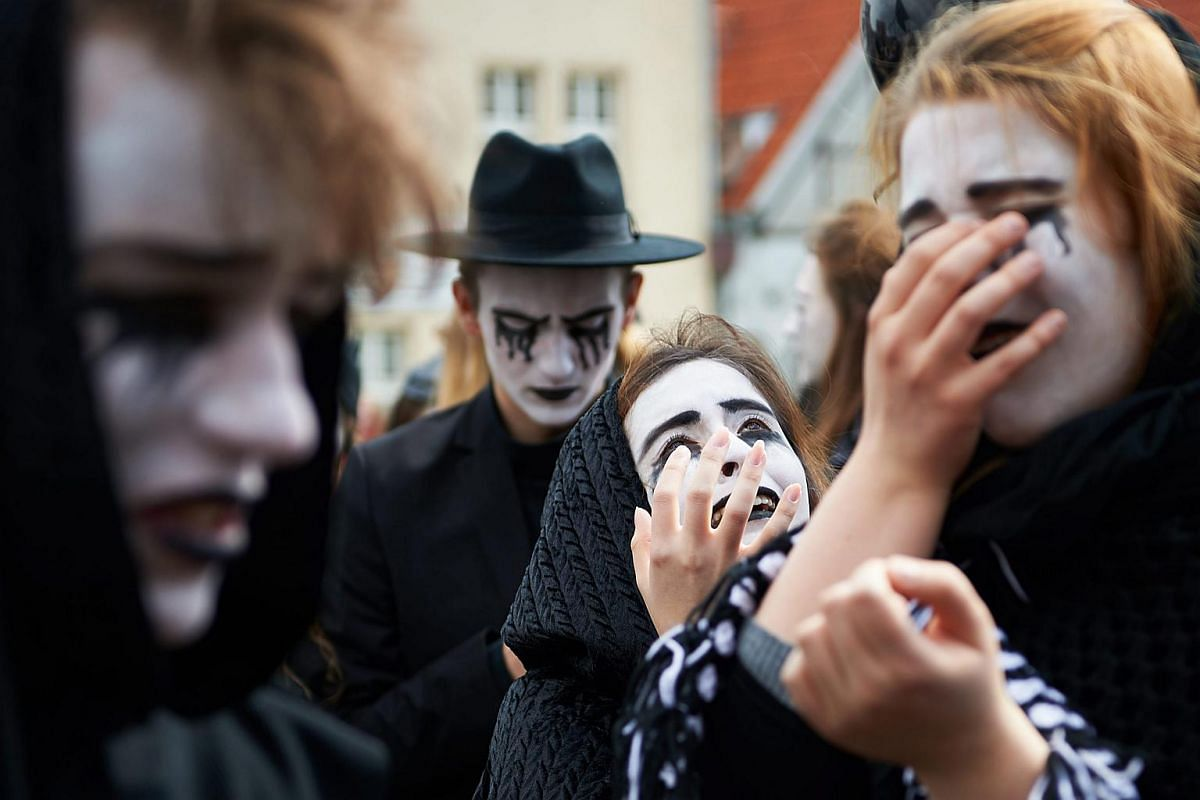 People dresses as mourners participated in an event marking the 400th anniversary of William Shakespeare's death, organised by Gdansk Shakespeare Theatre, in Gdansk, Poland, on April 23, 2016.