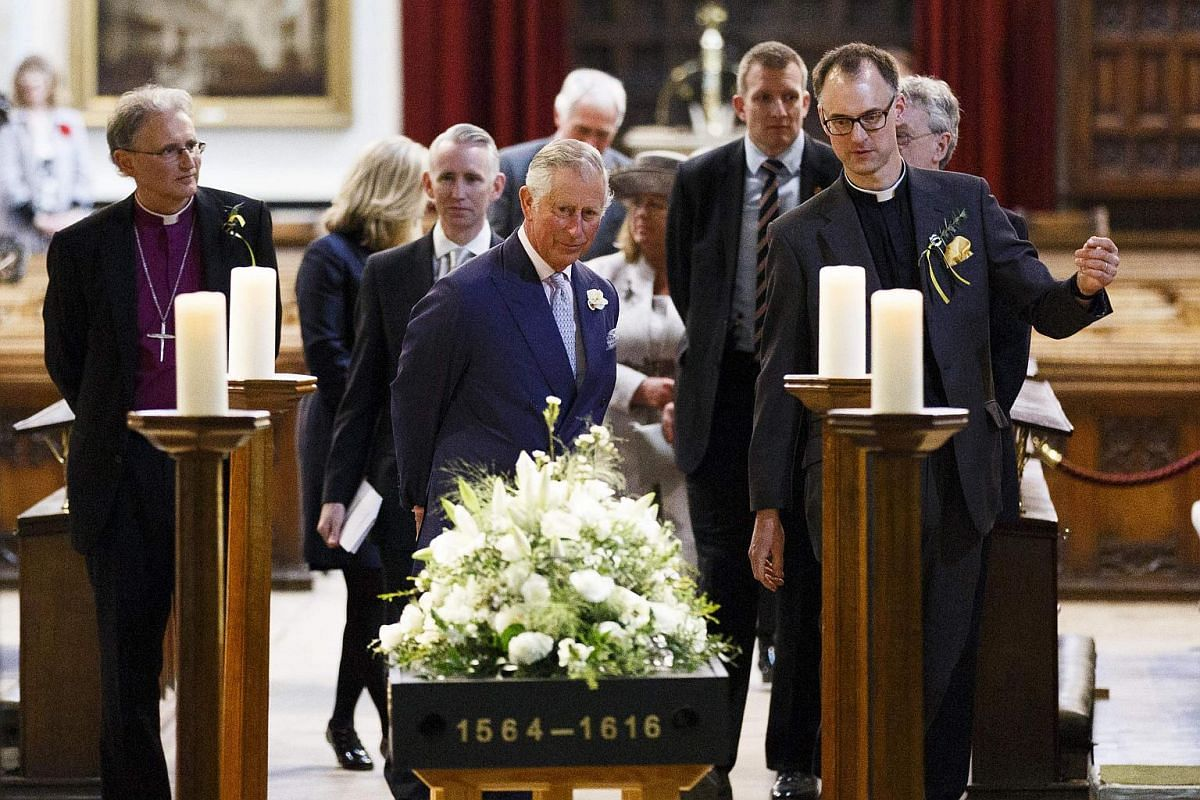 Britain's Prince Charles, Prince of Wales visits the Holy Trinity Church housing the grave of William Shakespeare in Stratford-upon-Avon, England, on April 23, 2016 in a visit to mark the 400th anniversary of the bard's death.