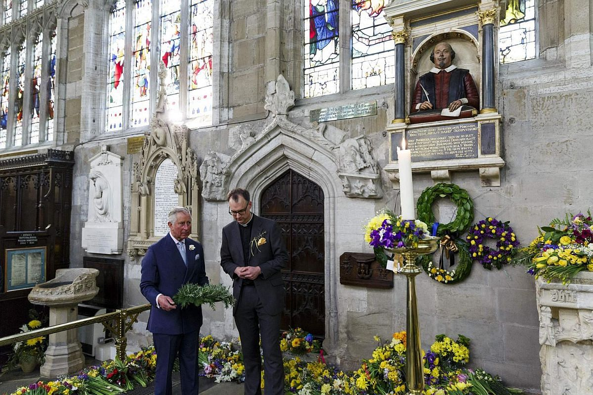 Britain's Prince Charles, Prince of Wales (left), lays a wreath on the grave of William Shakespeare in the Holy Trinity Church in Stratford-upon-Avon, England, on April 23, 2016 in a visit to mark the 400th anniversary of the bard's death.