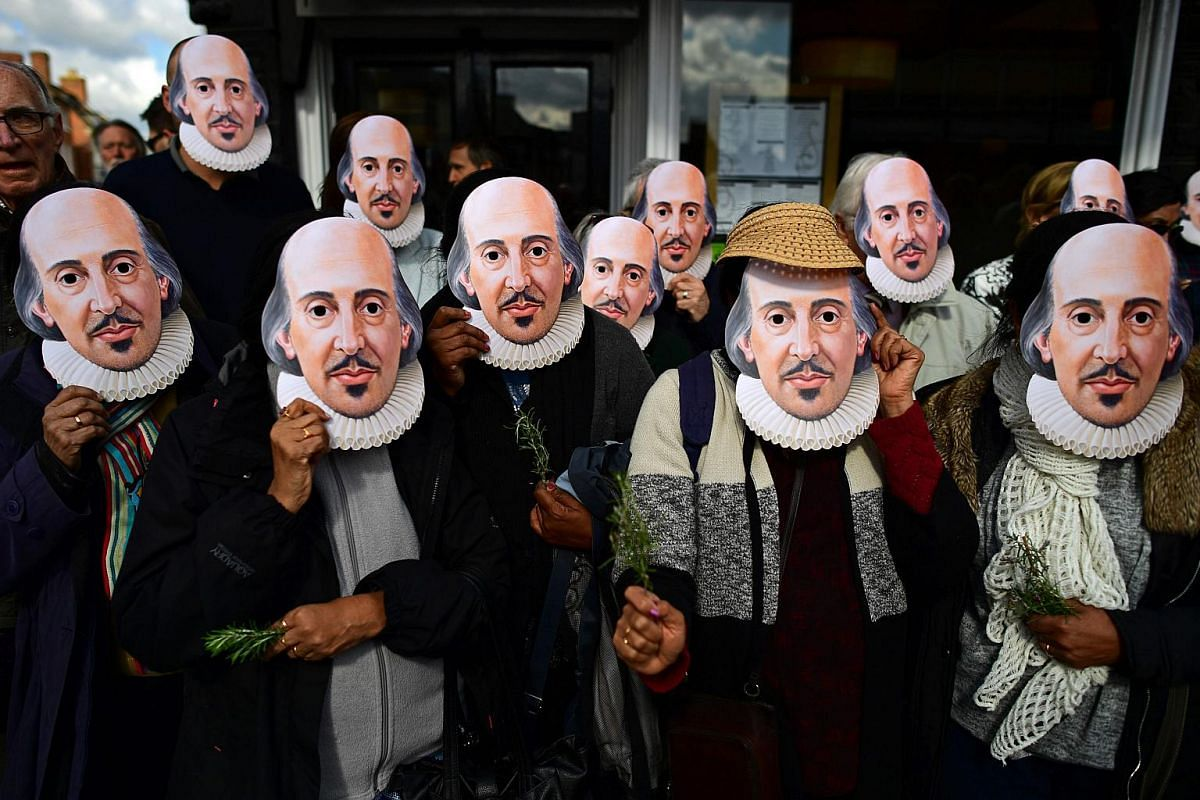 """Wearing masks of the """"Bard of Avon"""", members of the public prepare for the parade marking the 400 years since the death of William Shakespeare, in Stratford-upon-Avon in central England on April 23, 2016."""