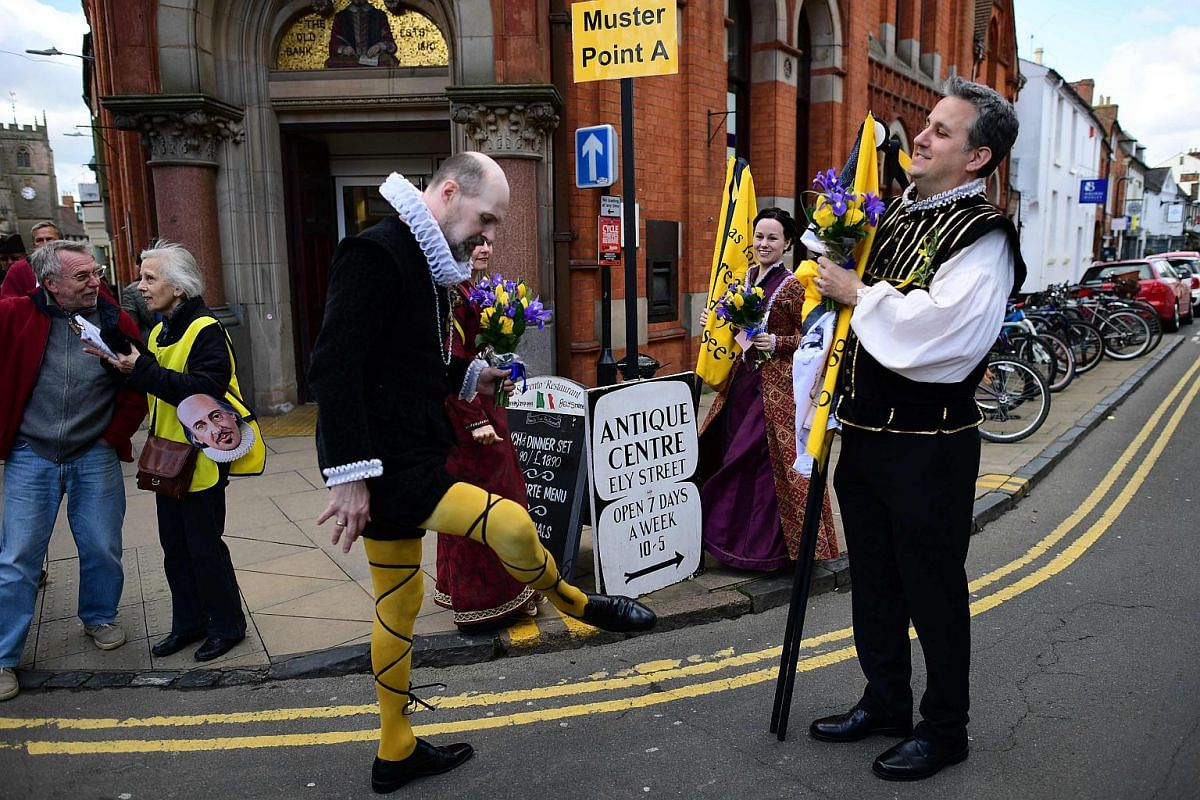 Members of Kentucky Shakespeare, the oldest free Shakespeare festival in the US, prepare for the parade marking the 400 years since the death of William Shakespeare, in Stratford-upon-Avon in central England on April 23, 2016.