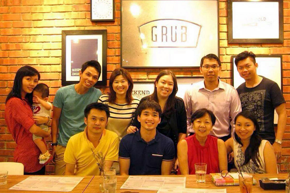 Former head prefect Chester Ong (standing, second from left) with his former schoolmates from Bukit Merah Primary School, which closed in 1997, at an alumni meet-up.