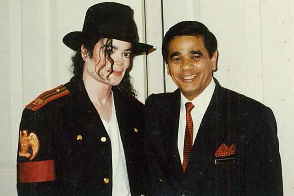 Mr Leslie Danker with Michael Jackson (both above) in 1993. Mr Danker, now 76, works part-time as a resident historian at Raffles hotel.
