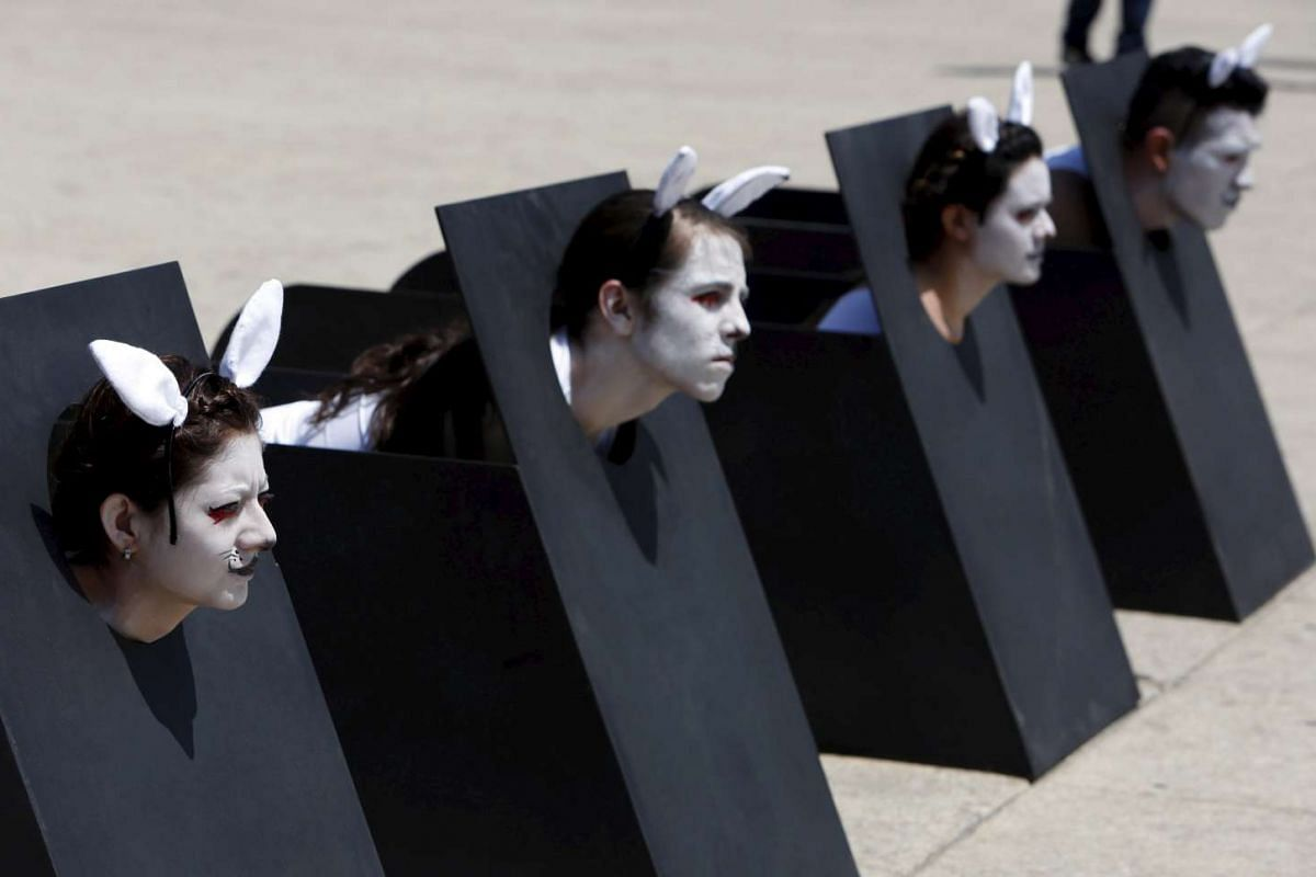 Activists from AnimaNaturalis take part in a demonstration against animal testing during World Day for Laboratory Animals at the Revolucion monument in Mexico City, Mexico, on April 24, 2016.