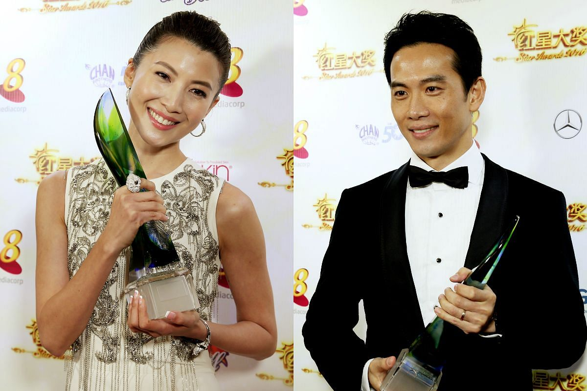Jeanette Aw (left) and Qi Yuwu with their Best Actress and actor awards.