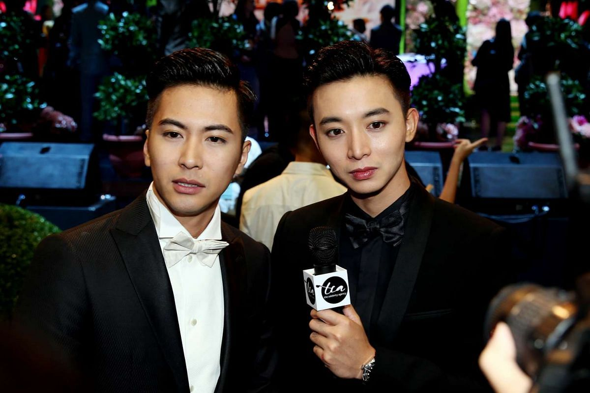 Xu Bin (left) and Aloysius Pang pose for the media at the Star Awards 2016. Xu Bin took home the award for Favourite Male Character for his role in You Can Be An Angel Too! while Aloysius won Top 10 Most Popular Male Artistes.