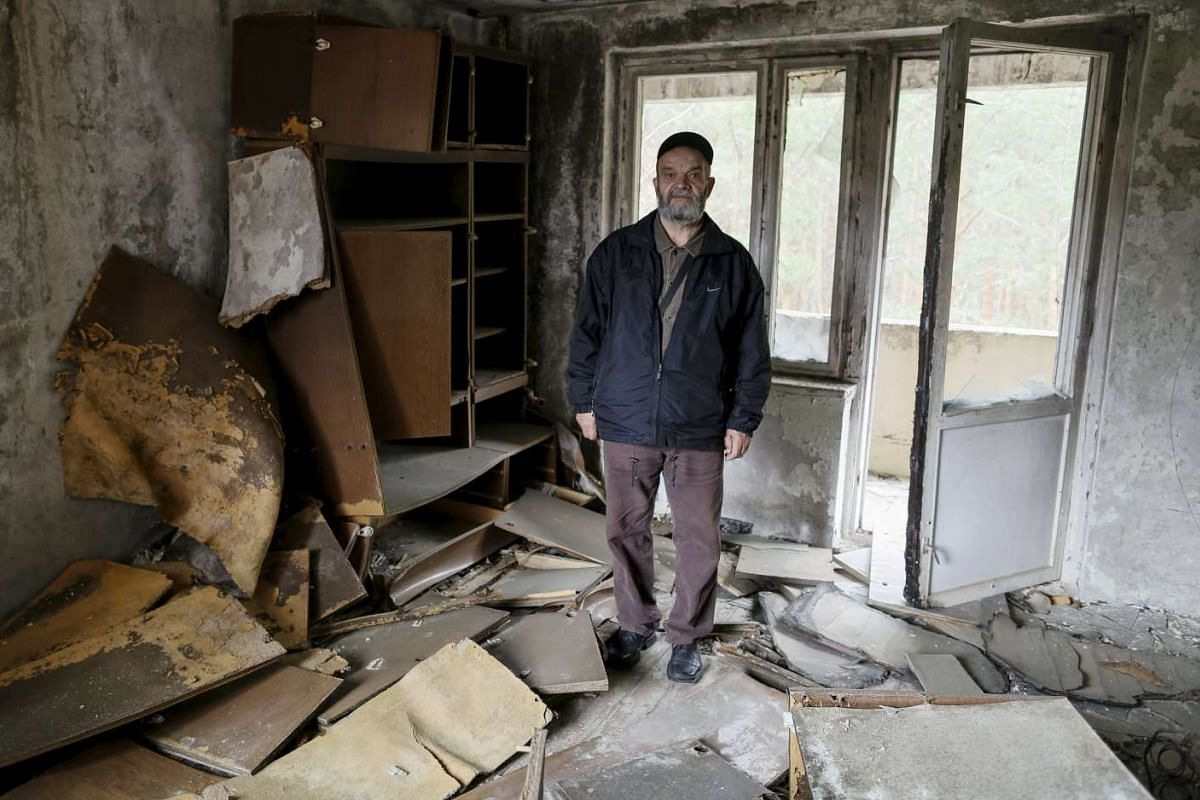 Nikolay Chernyavskiy in his flat which was evacuated after an explosion at the Chernobyl nuclear power plant, in the ghost town of Pripyat, Ukraine on April 18, 2016.