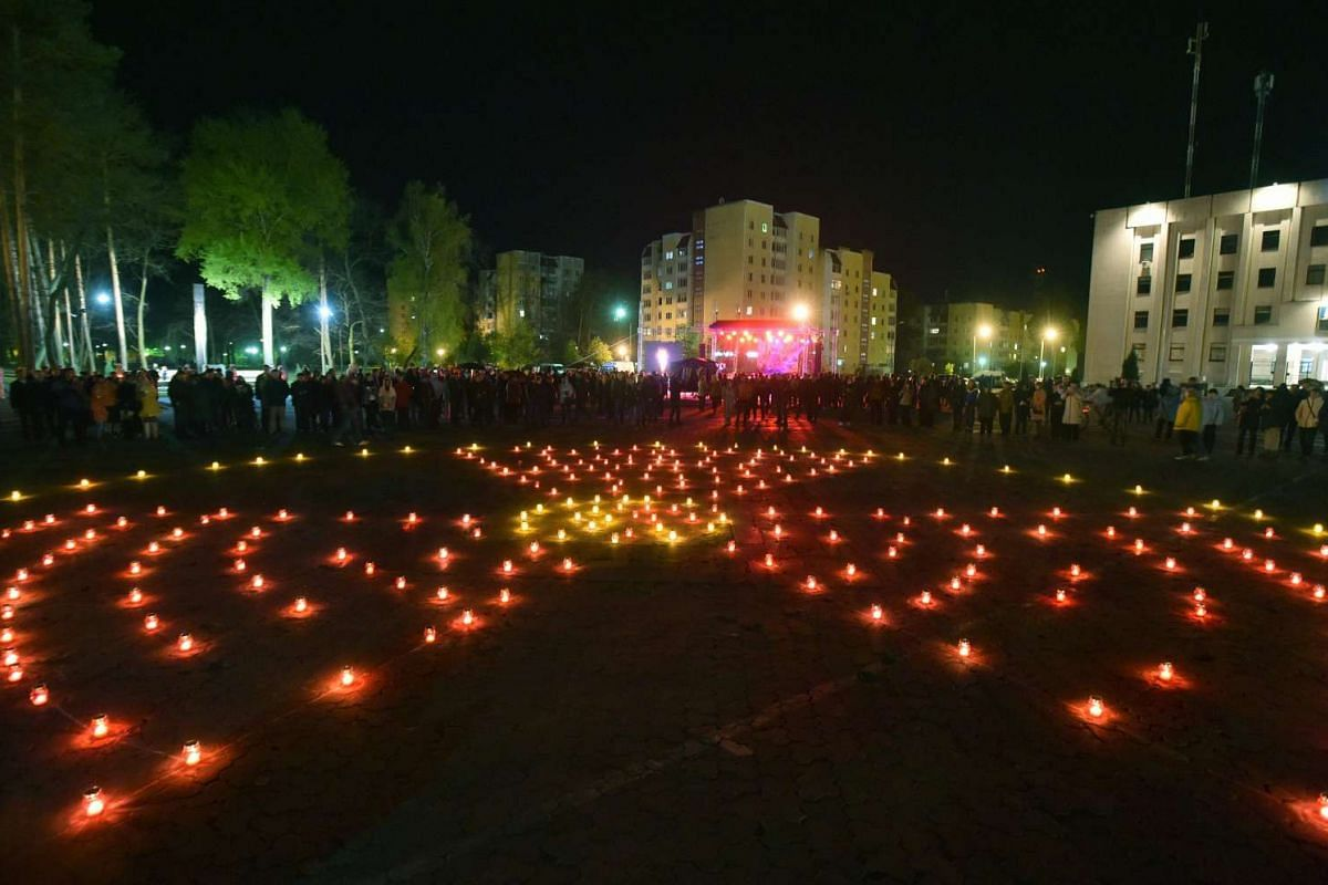 Candles set in the shape of a radiation hazard symbol on a square next to the monument to Chernobyl victims in Slavutich on April 26, 2016.