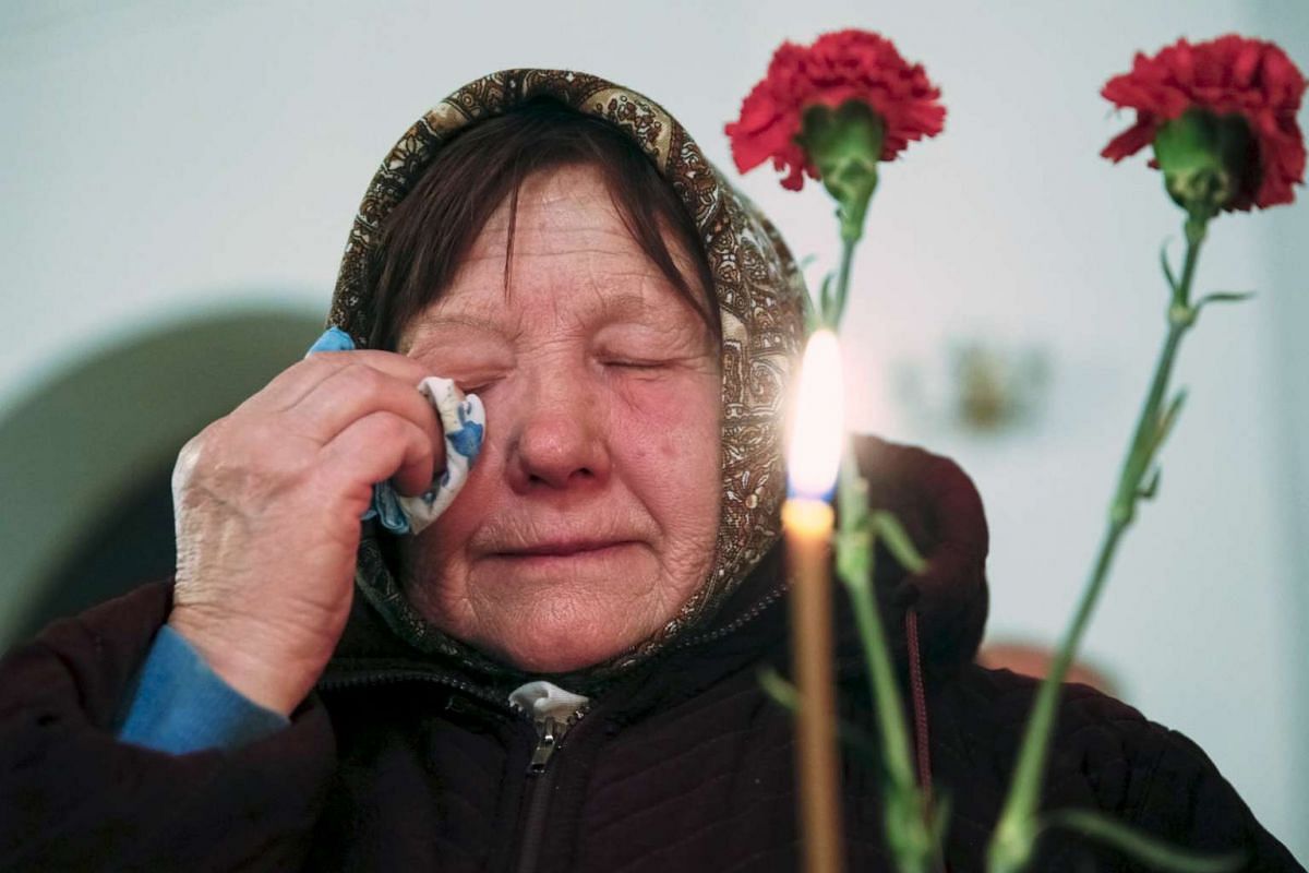 A woman cries during a memorial service for victims of the Chernobyl nuclear disaster in a church in Kiev, Ukraine, on April 25, 2016.