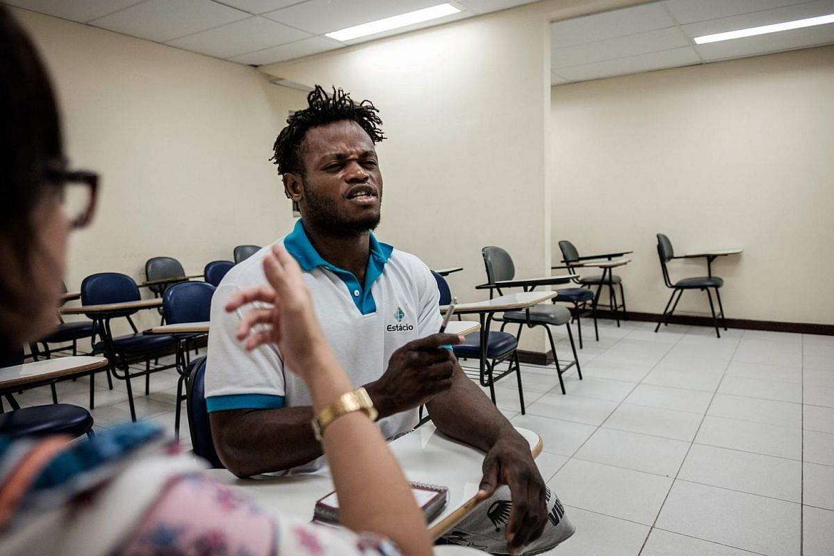 Popole Misenga, 24, a refugee judoka from the Democratic Republic of the Congo, taking lessons in Portuguese before a training in Rio de Janeiro, Brazil, on April 14, 2016.