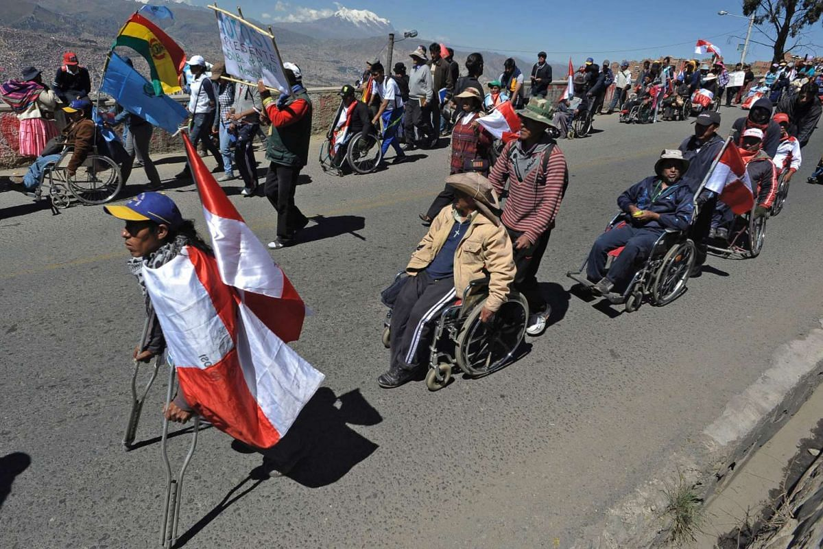 People on wheelchairs arrive in La Paz, Bolivia, on April 25, 2016.