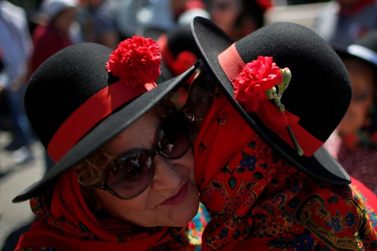 Two women kiss during a march marking the Carnation Revolution's 42nd anniversary in Lisbon, Portugal, on April 25, 2016.