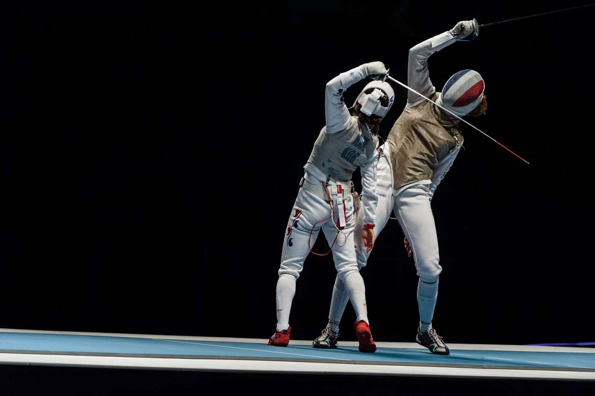 France's Ysaora Thibus (right) competes with South Korea's Hyunhee Nam during the test event of the Fencing World Championships Women's Foil Team match for the Bronze for the Rio 2016 Olympic Games on April 26, 2016.