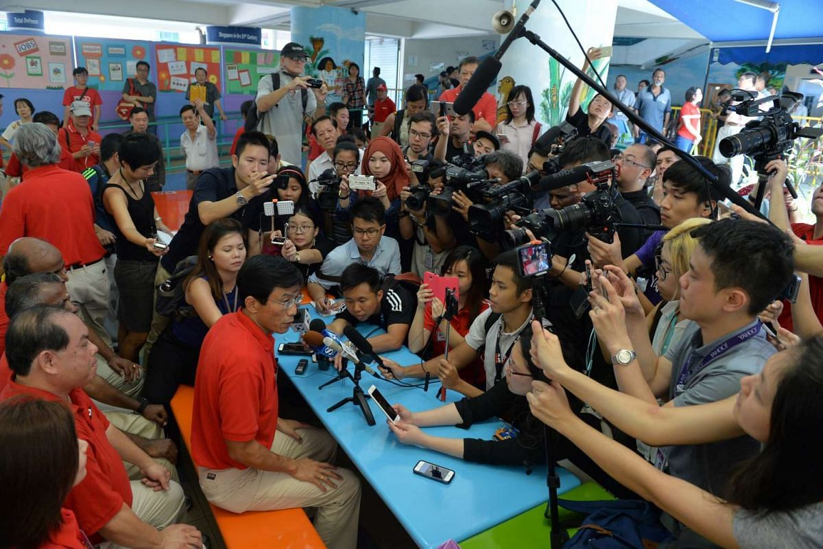 12:55pm: Dr Chee Soon Juan holding a press conference in the canteen of Keming Primary School after his nomination was confirmed.