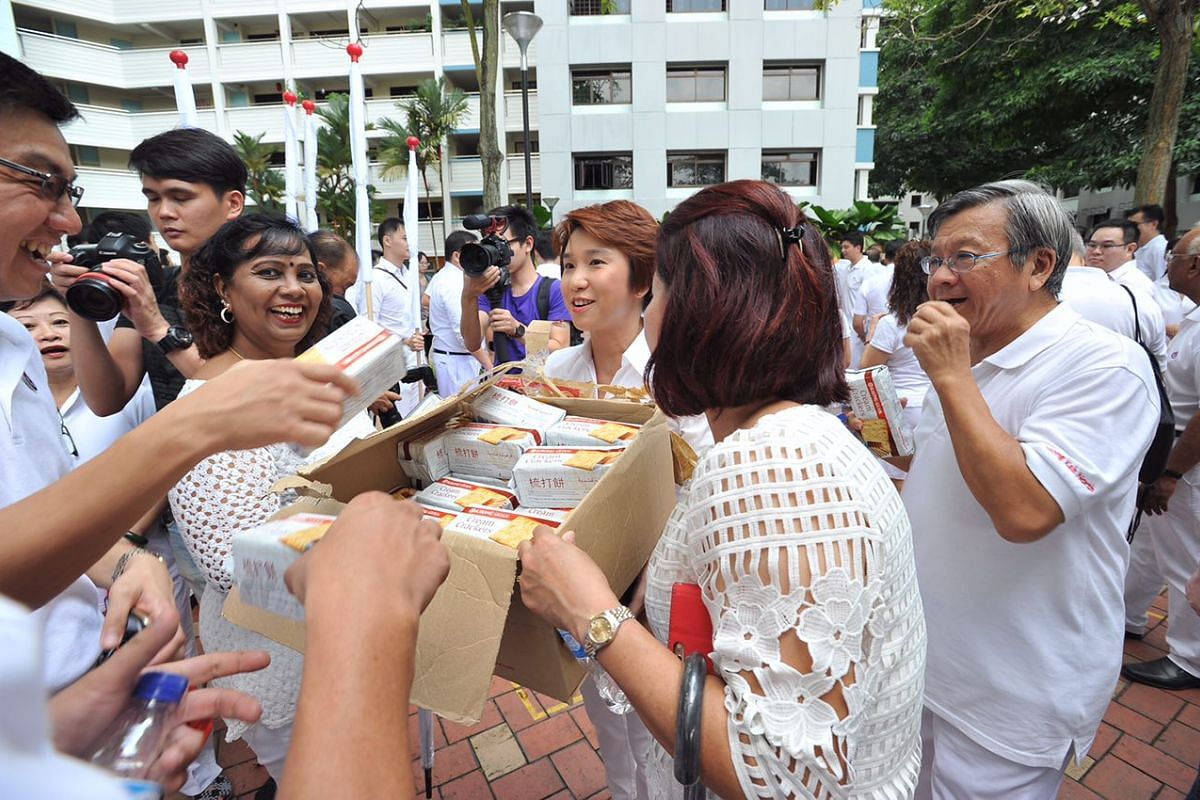 9:30am: People's Action Party (PAP) supporters off to an early start, gathering in front of Block 291A Bukit Batok Street 24.