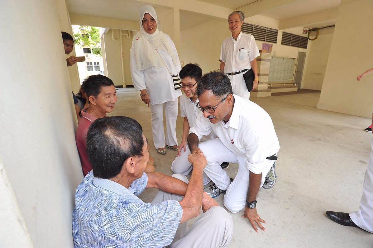 1:01pm: PAP's Mr Murali Pillai speaking to a resident at a Bukit Batok void deck.