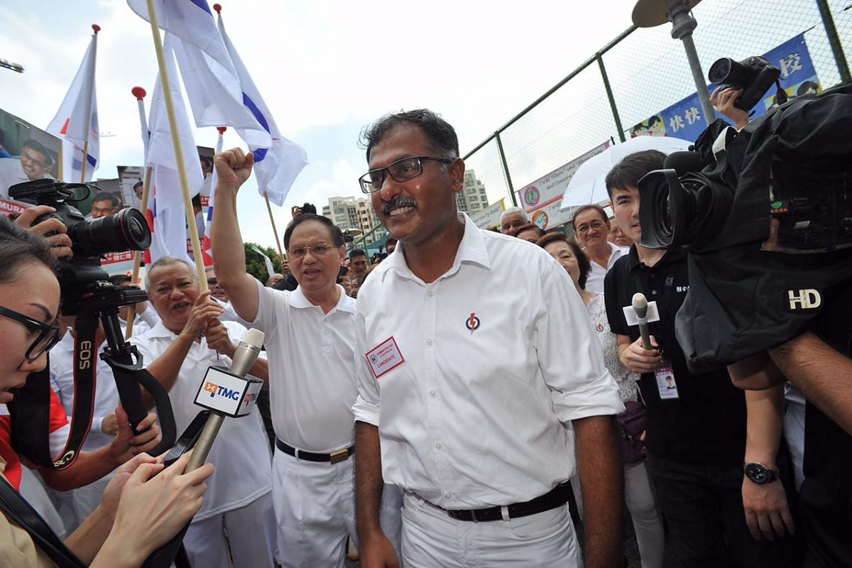 12:48pm: After his nomination was announced, PAP candidate Murali Pillai sets off for media interviews outside Keming Primary School, before a walkabout around Bukit Batok.