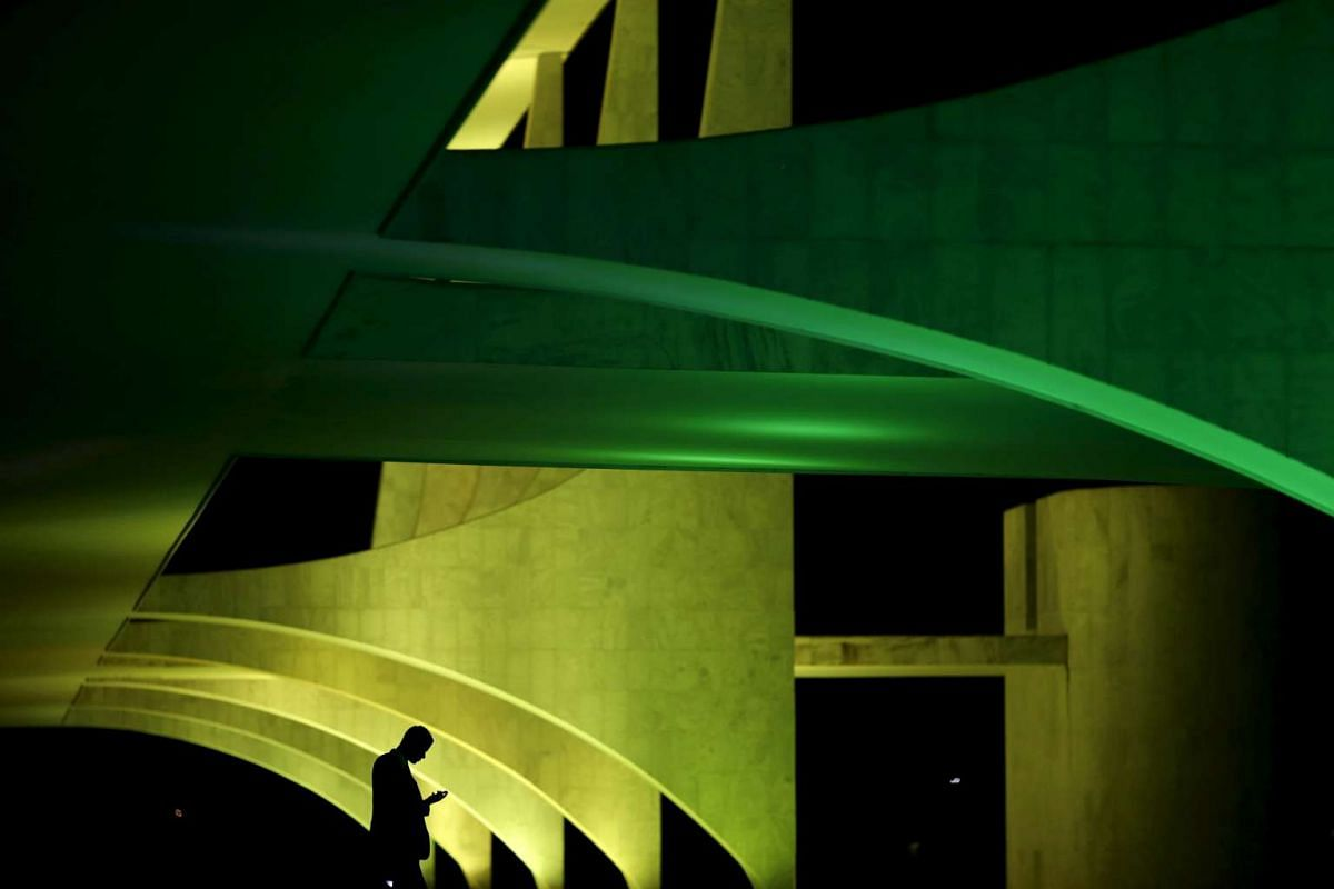 Planalto Palace is lit in the colours of Brazil's flag in celebration of the 100 days before the 2016 Rio Olympics in Brasilia, Brazil, on April 27, 2016.