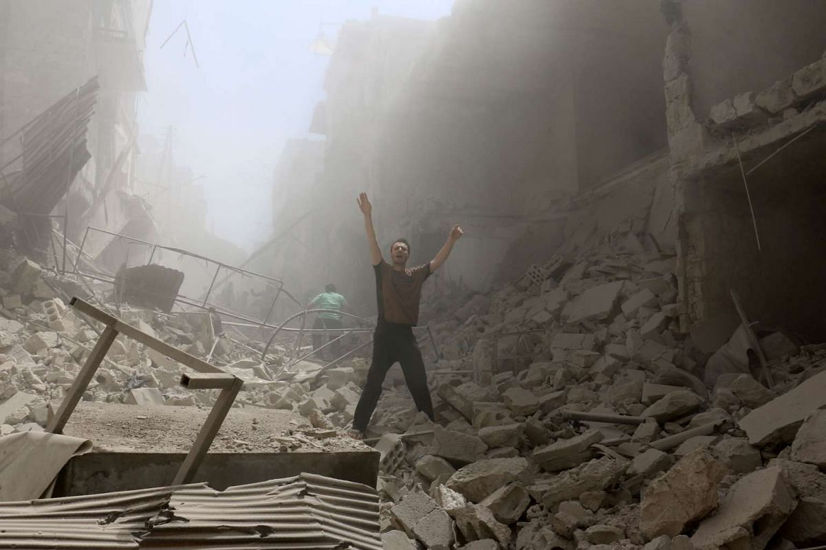 A man amid the rubble of destroyed buildings after an air strike on the rebel-held neighbourhood of al-Kalasa in Aleppo.