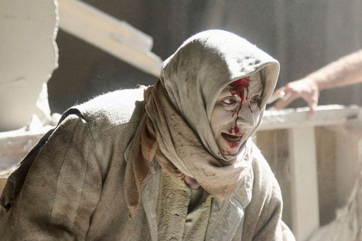 An injured woman at the site of air strikes in Old Aleppo on Thursday, April 28, 2016.