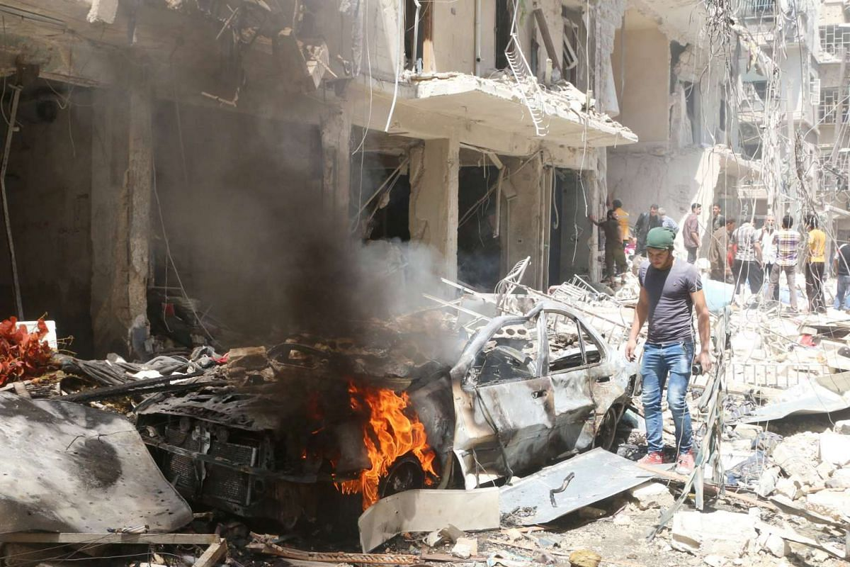 People inspecting the damage at the site of air strikes in the rebel-held area Bustan al-Qasr in Aleppo on Thursday, April 28, 2016.