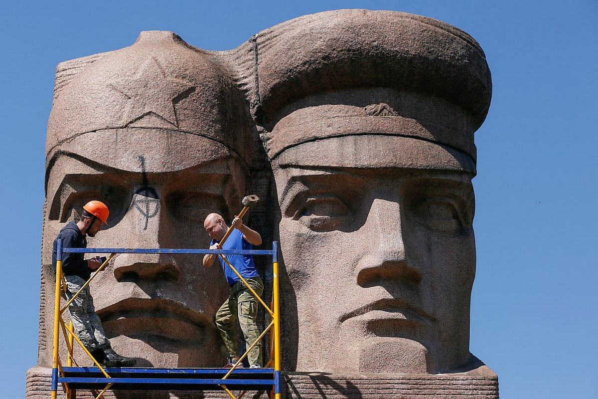 Ukrainian nationalists hammer the Cheka (All-Russian Extraordinary commission for combating Counter-revolution and Sabotage) officers monument in Kiev, Ukraine, on April 28, 2016.