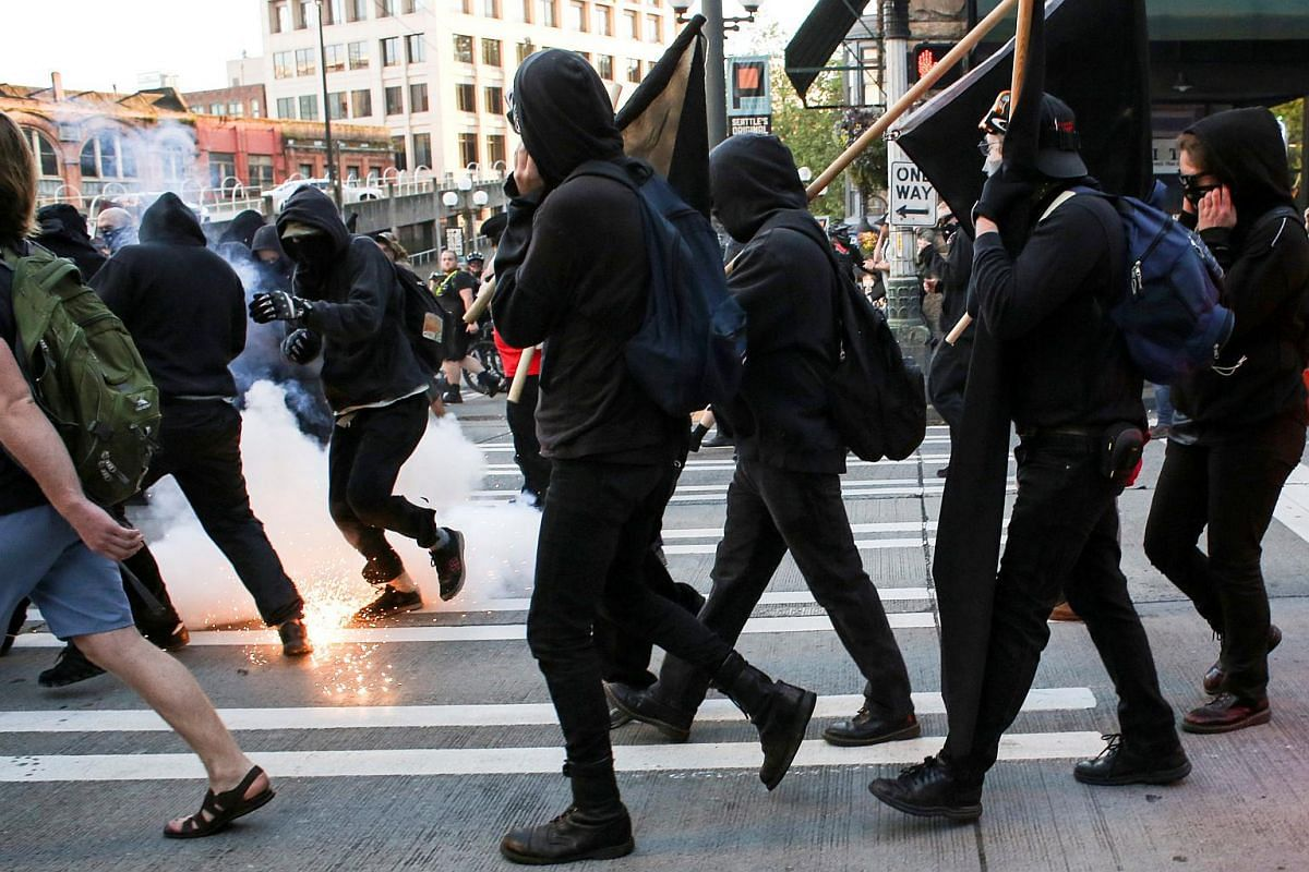 A police flashbang device exploding among a crowd of demonstrators during anti-capitalist protests following May Day marches in Seattle, Washington, on May 1, 2016.