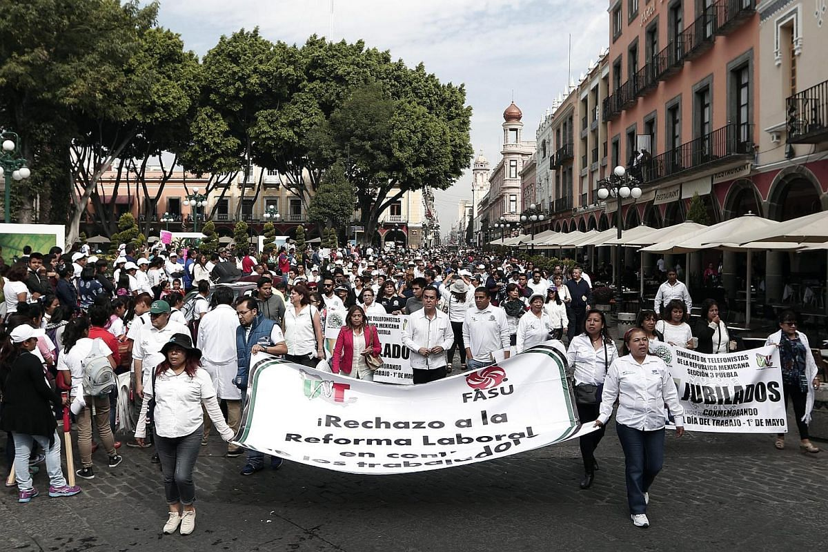 Thousands of people participating in the International Workers Day parade in Puebla, Mexico, on May 1, 2016.
