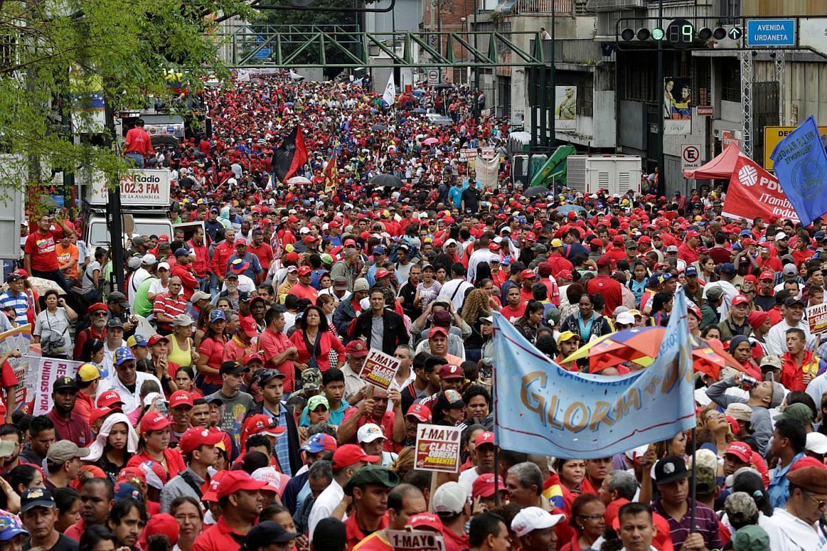 Supporters of Venezuela's President Nicolas Maduro attending a rally to commemorate May Day, in Caracas, Venezuela, on May 1, 2016.