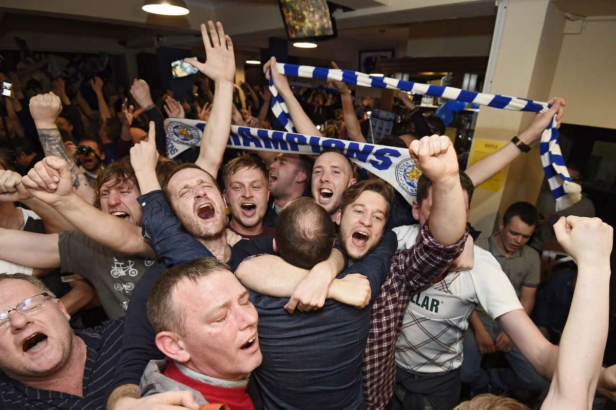 Leicester City supporters celebrate after the English Premier League soccer match between Chelsea and Tottenham Hotspur, in Leicester, Britain, May 2, 2016. PHOTO: EPA